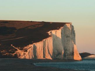 A tourist fell to her death while jumping for a photo at the edge of the famous Seven Sisters cliffs